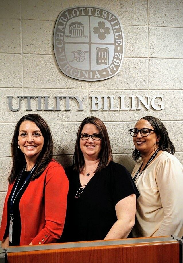 Three Women in front of the Utility Billing Office